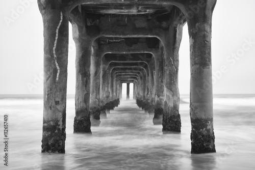 Under the Pier. Black and white photo Manhattan Beach, Californi