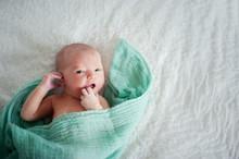 New Born Baby Lying On Sheet