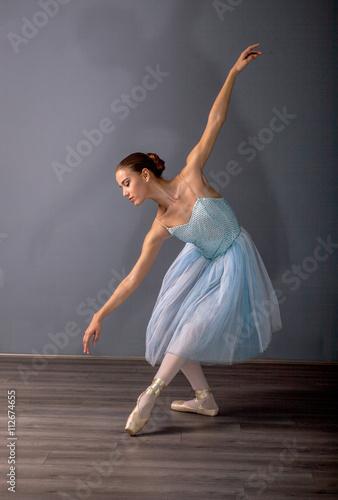 fototapeta na lodówkę young ballerina in ballet pose classical dance