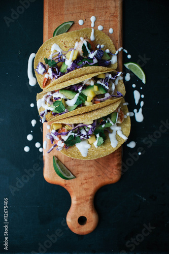 Láminas  Tacos on wooden board