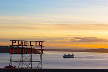 Sunset Over Puget Sound In Seattle. Pike Public Market Neon Sign At Sunset.