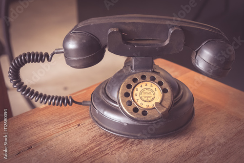 old classic telephone on wood table - Buy this stock photo and