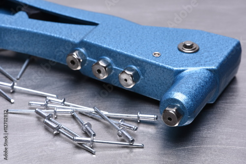 Fotografie, Obraz  Hand rivet tool on metal surface