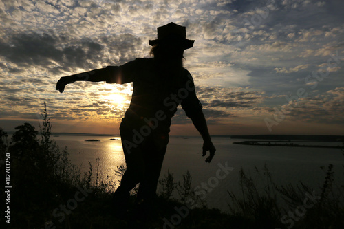 Foto op Canvas Jacht silhouette of a man on the river bank