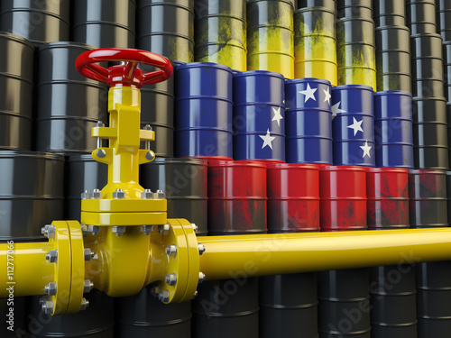 Photo  Oil pipe line valve in front of the flag of Venezuela on the oil
