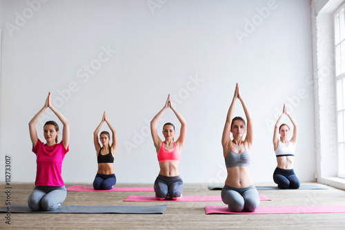 Group of people at the gym in a yoga class Fototapeta