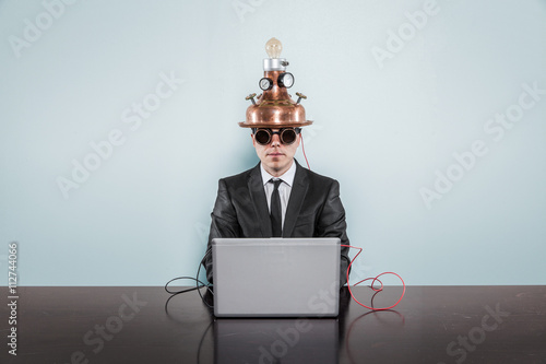 Fotografía Vintage businessman sitting at office desk