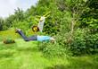 Leinwanddruck Bild - Man flies with wheelbarrow in a bush.