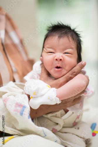 Valokuva  Grand  mom hand holding baby neck make ing belch after drink milk