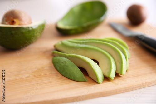 Fresh sliced avocado on cutting board
