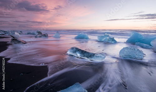 Icebergs on black volcanic beach in glacial lagoon, Iceland. Vatnajokull National Park
