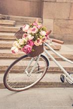 Vintage Girls Bicyclewith Flowers In Basket