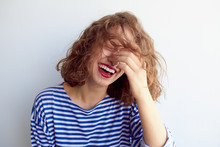 Laughing Woman With Curly Hair...