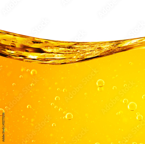 Valokuvatapetti Liquid flows yellow, for the project, oil, honey, beer