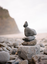 Pebbles Stacked On Beach