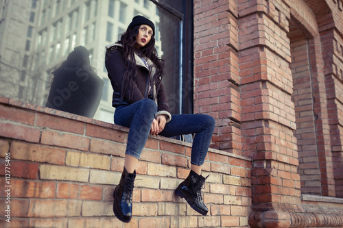 Outdoor lifestyle portrait of pretty young girl, wearing hipster swag  grunge style on urban background