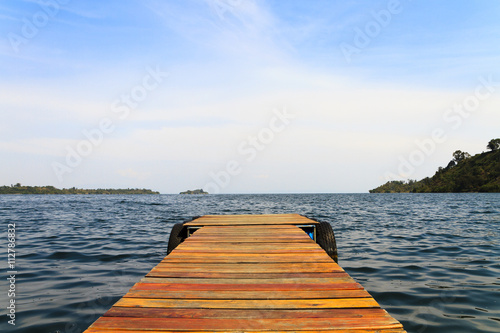 Wooden dock on a lake - 112786832