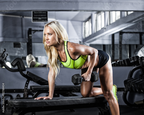 fitness girl exercising with barbell in gym - 112788434