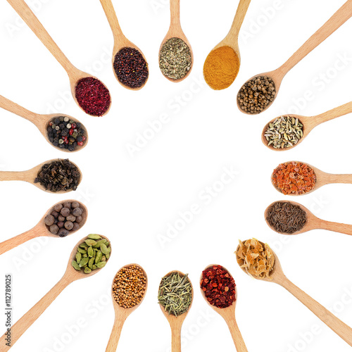 Photo Stands Herbs 2 Collection of spices in wooden spoons, isolated on white