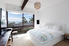 View Of The Ocean From A Retro Beach House Bedroom