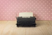 Image Of Vintage Typewriter On Pink Polka Dots Wallpaper