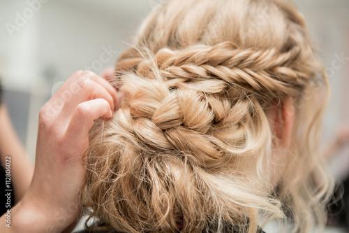 Obraz Application of wedding makeup. Preparation of the bride. Boho style. Ease of braided hair braids. - fototapety do salonu