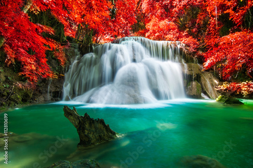 Wall Murals Waterfalls Waterfall in beautiful autumn forest