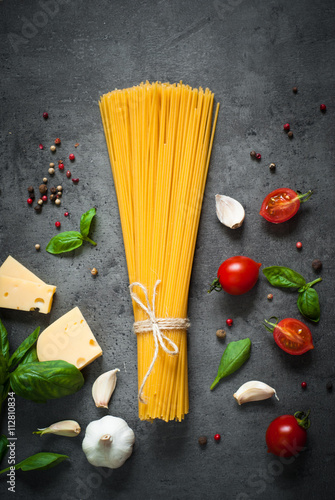 Slika na platnu Ingredients for cooking Italian pasta
