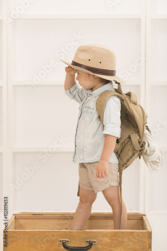 54822579b08f5 Adorable little girl in a safari hat and explorer clothes playing safari in  a wooden suitcase