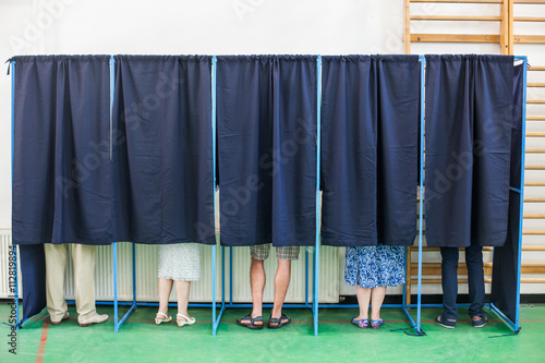 Valokuva  People voting in booths