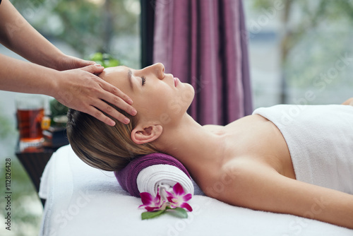 Chinese pretty woman receiving head massage in salon Canvas
