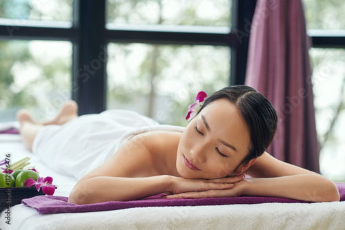 Fotografie, Obraz  Beautiful Asian woman sleeping after relaxing spa procedure