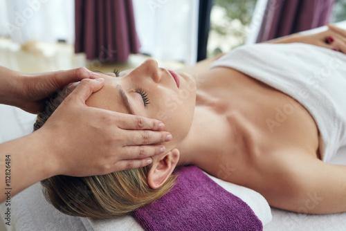 Obraz na plátně  Woman having face lifting procedure in salon