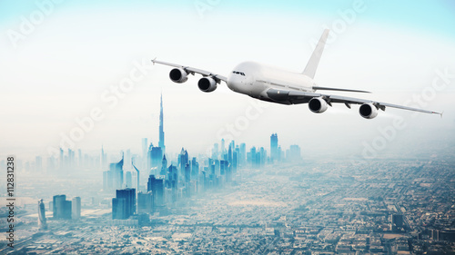 Recess Fitting Dubai Commercial airplane flying over modern city