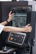 Engineer's hand on working computer panel of CNC machine