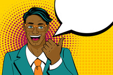 Young Surprised Afro American Man With Open Mouth Pointing Finger With Speech Bubble In Pop Art Retro Style. Vintage Vector Character. Pop Art Vector Background.