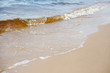 Waves. Sand. Sea. Outdoor recreation concept. Summer background.