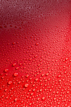 Smooth Red Surface Covered With Rain Drops