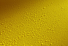 Water Drops Beading On A Yellow Metal Surface