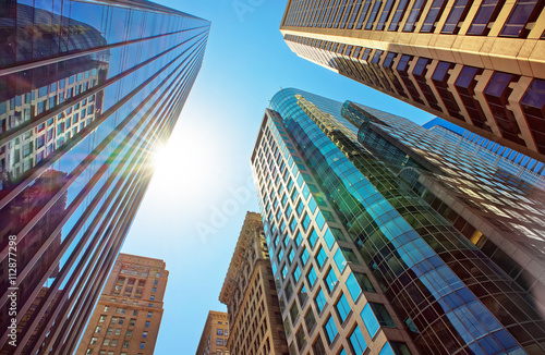 Bottom-up view of skyscrapers mirrored in glass in Philadelphia Wallpaper Mural