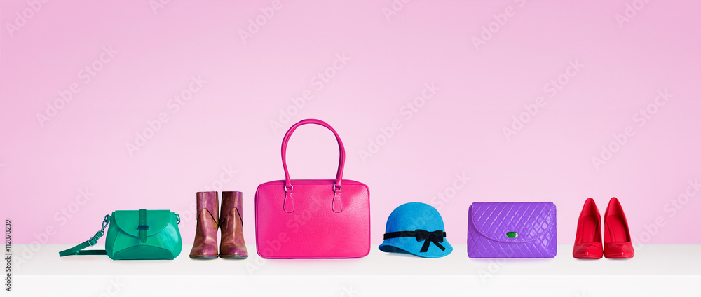Fototapety, obrazy: Colorful hand bags,purse,shoes, and hat isolated on pink background. Woman fashion accessories items. Shopping image.