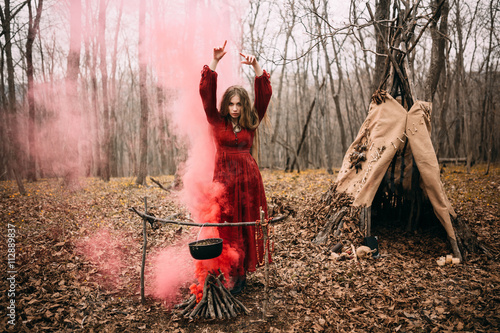 Stampa su Tela Young witch in the autumn forest