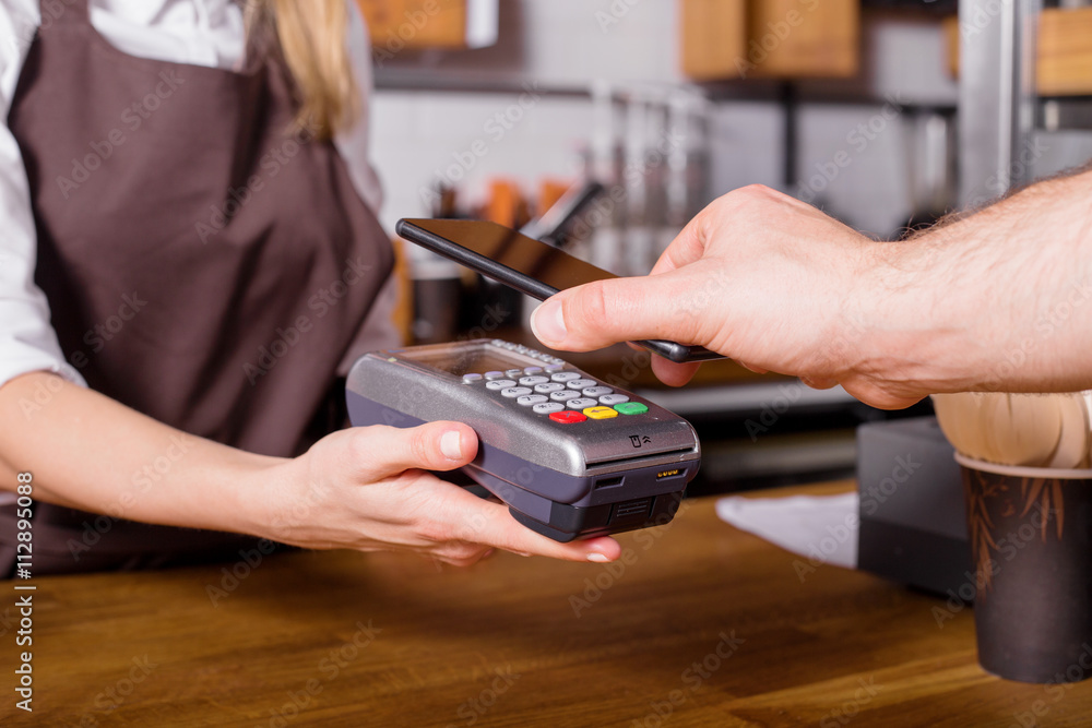 Fototapeta costumer scaning phone to pay