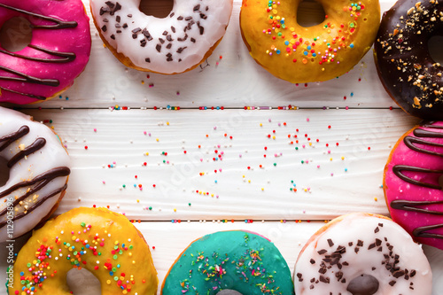 Photo  donuts on a wooden background and space for text