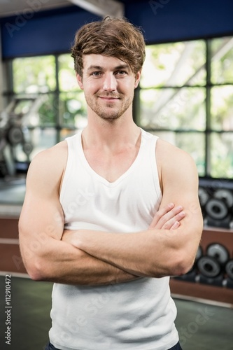 Handsome man standing in gym Canvas Print