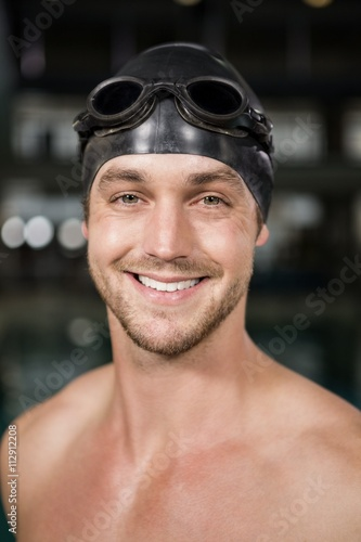 Portrait of swimmer wearing swimming goggles and cap Canvas Print