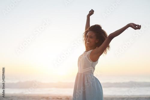 Photo  She always feels free at the beach