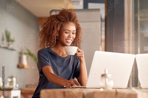 Enjoying a cup of coffee in her favorite cafe Canvas Print