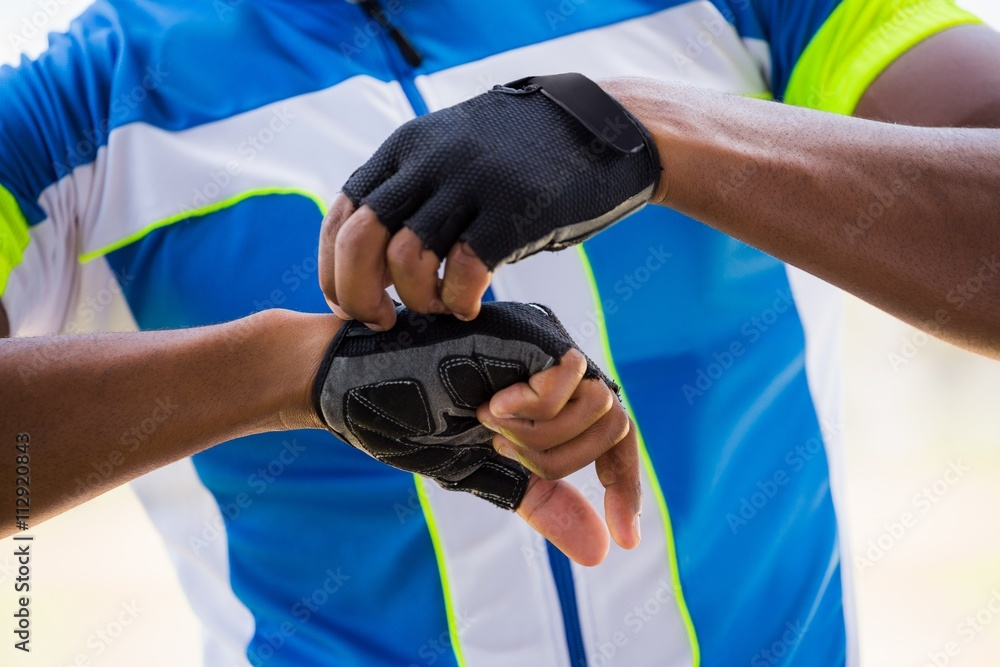 Athlete wearing cycling gloves Poster