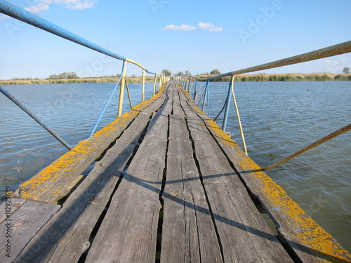 obraz lub plakat Old wooden broken damaged bridge